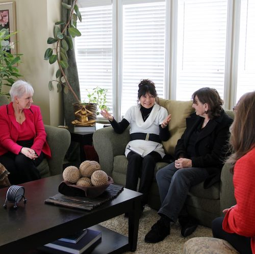 A group of women meeting in a living room