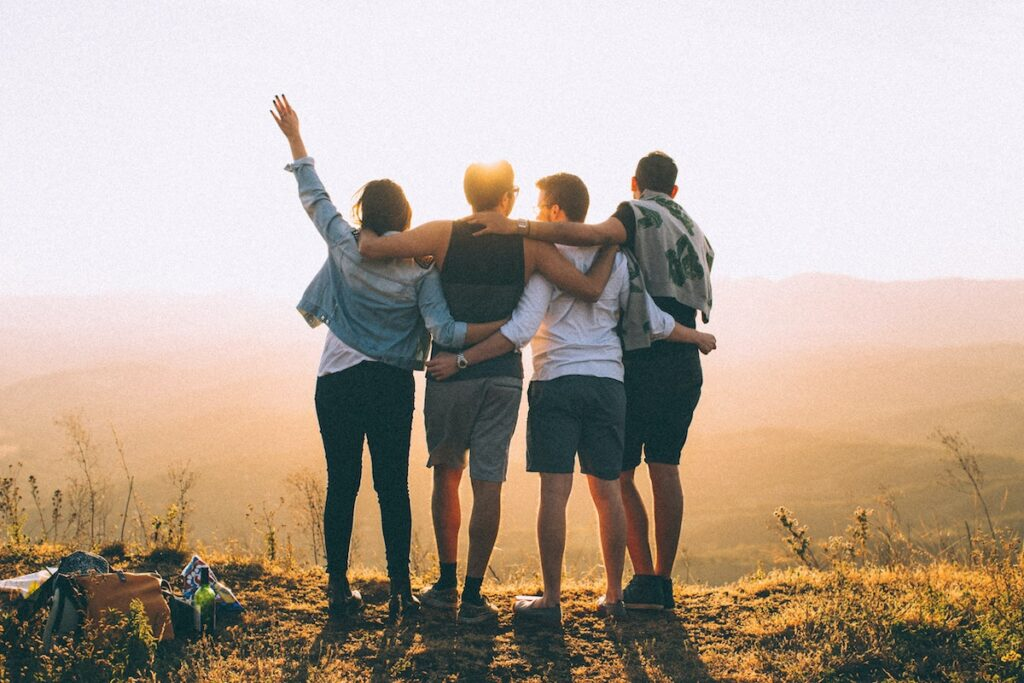 Group of friends looking at the sunrise