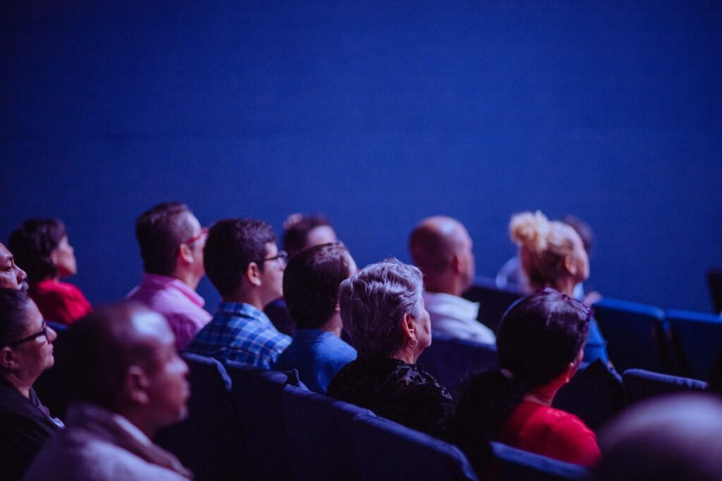 People sitting in chairs at a conference