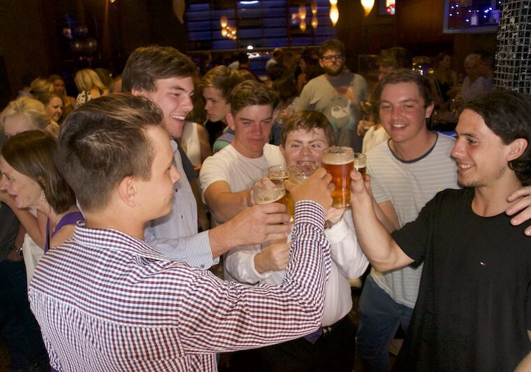 Sean and his friends drinking beer at the pub